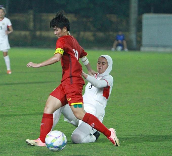Việt Nam beat Jordan to top Group E